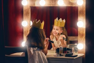 The Actor is the agent or group performing an action in an activity statement. Cute little actress. Child girl in Princess costume on the background of theatrical scenes and mirrors.
