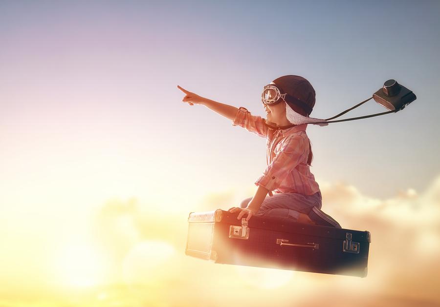 boy flying on a magic briefcase.